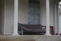 Student home with futon on front porch - 2016